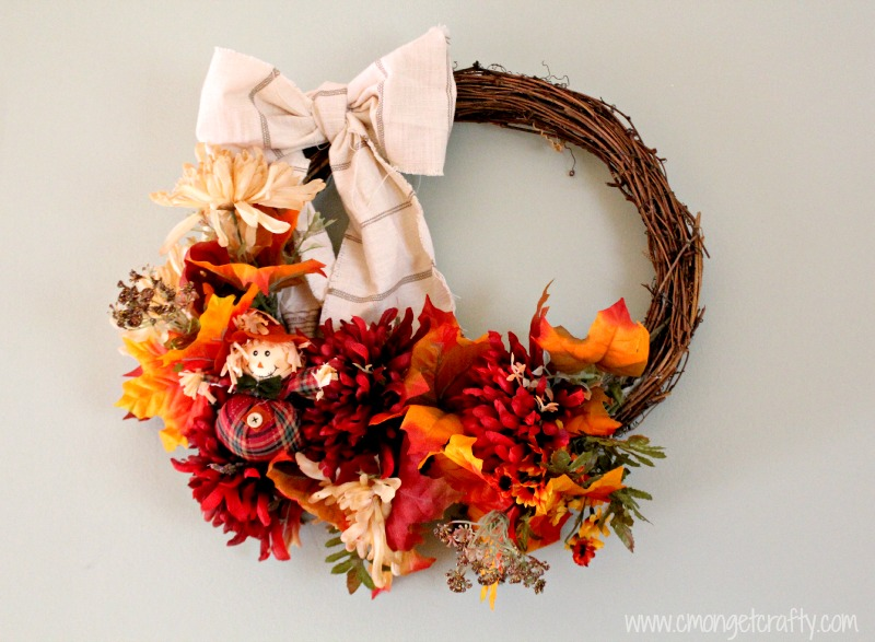 Make a pretty fall wreath in thirty minutes or less - and on the cheap! Take old decor or dollar store items and repurpose for beautiful fall decor!