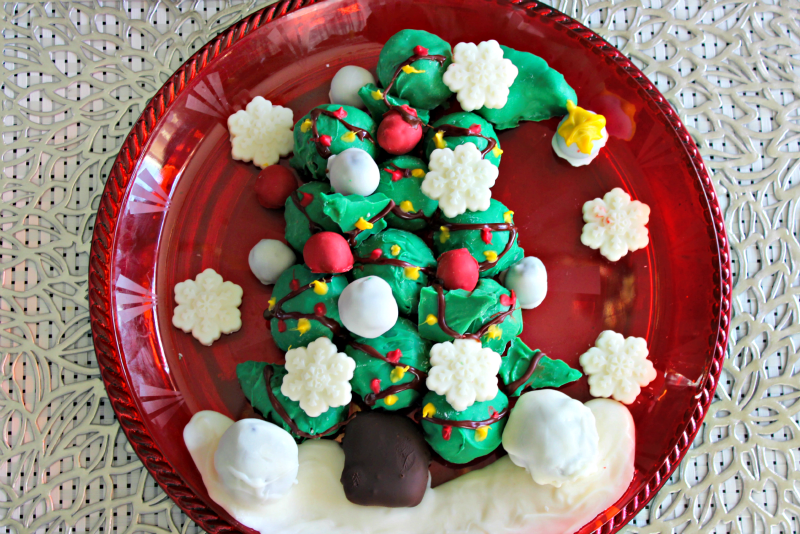 This OREO Cookie Balls Grinch Tree is easy and simple to make, but adds some great flair to your holiday tablescape!