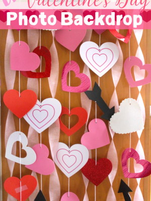 This DIY Valentine's Day photo backdrop can be easily made with dollar store finds or just paper, scissors, and string!