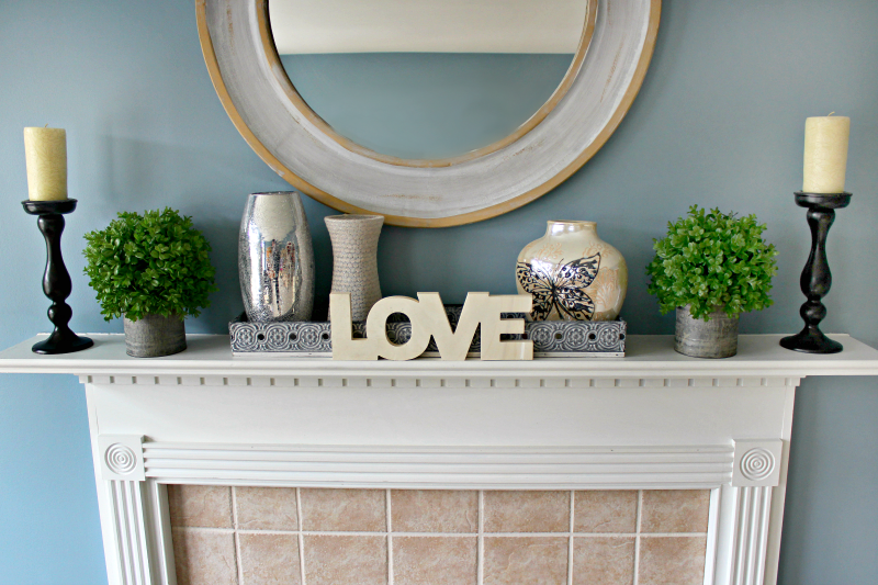 Need some inspiration for mantel decor now that the holidays are over? See how I used boxwood to style a fresh look for my after Christmas mantel.