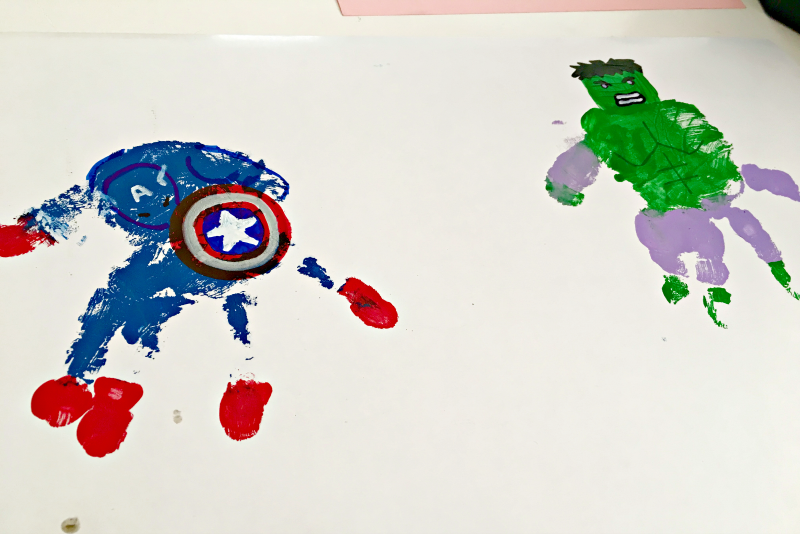 My son loves the Avengers, but I love making art meaningful. So we struck a compromise with this superhero handprint art!