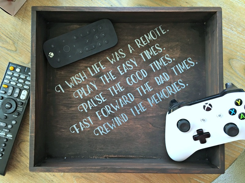 For this month's thrift store up cycle I decided to make use of an old box to store the hundreds of remotes we own.
