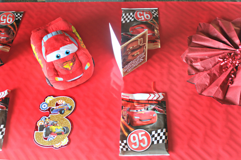 My 3 year old wanted a Disney CARS birthday party this year, so I worked up some easy party decorations and the BEST homemade cake design! #ad #CARSbirthdayparty