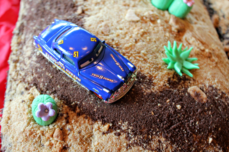 My boys are both huge fans of the Pixar CARS movies, and I had a BLAST making this Radiator Springs birthday cake for my youngest!
