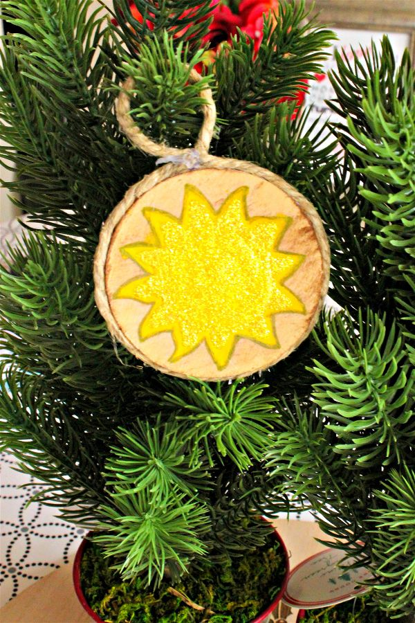 Sometimes winter doesn't mean only Christmas, but also the winter solstice. If you celebrate winter solstice,or the sun's rebirth.  This wood tree ornament might be perfect for you to celebrate Yule this year.