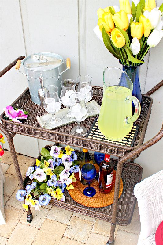 After the long Chicago winter, I'm SO ready to embrace the warmth of spring! Spend as much time outside as you can by styling a spring bar cart, always ready for outdoor entertaining! #ad #Wayfair #spring #barcart #sangria #springdecor