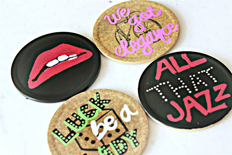 This painted coasters DIY is one of my favorite #MovieMondayChallenge crafts! I was so excited to design some of my favorite show lyrics into art! #paintedcoasters #sharpie #musicals #moviemonday #diy #sharpiecrafts #paintit #paintedcrafts #sharpiepaintpens #rockyhorrorpictureshow #hellodolly #guysanddolls #chicago #allthatjazz #luckbealady #lips #wegotelegance #picmonkey